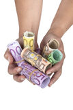 Rolled up Euro banknotes hold by female hands Royalty Free Stock Image