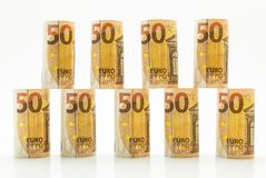 Rolled up 50 euro banknotes in rows. Isolated on a white background. stock photo