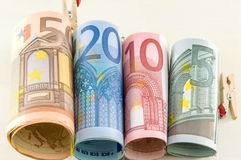 Rolled up euro bill monete Royalty Free Stock Photos
