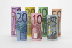 Rolled up Euro bills Stock Photo