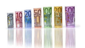 Rolled up Euro bills. On white background Royalty Free Stock Image