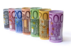 Rolled up Euro bills. On white background Stock Images