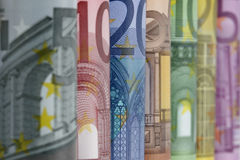 Rolled up Euro bills, close up Stock Images