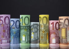 Rolled up Euro bills on dark background Royalty Free Stock Photography