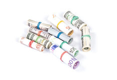 Rolled up Euro and dolar bills Stock Images