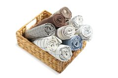 Rolled up fabric napkins in basket isolated royalty free stock photography