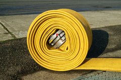 Rolled up fire hose. Kent, WA, USA November 14, 2016: Fire hose tightly rolled up after being used to put out fire in commercial building in Kent, Washington Stock Images