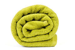 Rolled up green towel Royalty Free Stock Image