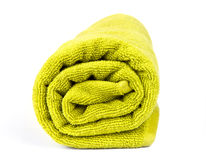 Rolled up green towel. Isolated on white Stock Photos