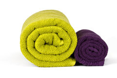 Rolled up green and violet towels Royalty Free Stock Photography
