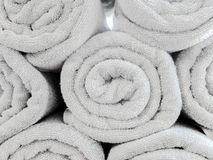 Rolled Up Light Gray Cotton Beach Towel Pattern used as Background Texture Stock Images