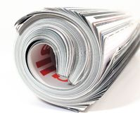 Rolled up Magazine Stock Images