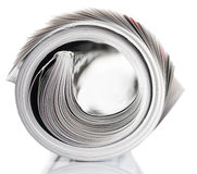 Rolled up magazine. Magazine rolled up on white background with reflection Royalty Free Stock Image