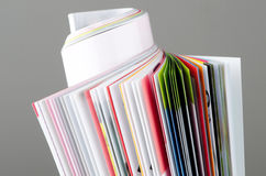 Rolled up magazine. Colorful rolled up magazine with clipping path Royalty Free Stock Images