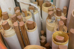 Rolled-up maps. On wooden sticks in a bucket royalty free stock images