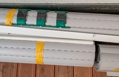 Rolled-up metal window shutters royalty free stock photos