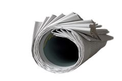 Rolled up newspaper. Isolated on white background, free copy space Royalty Free Stock Image