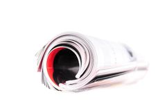 Rolled up newspaper Stock Photos