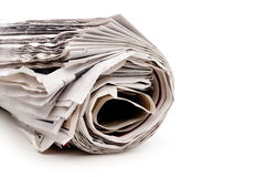 Rolled up newspaper on white Royalty Free Stock Photo