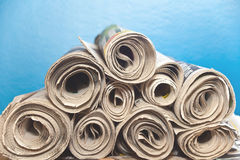 Rolled up Newspapers in a stack Stock Photo