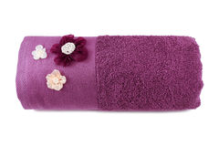 Rolled up purple decorated terry towel Royalty Free Stock Photography