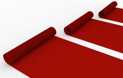 Rolled up red carpet Stock Images