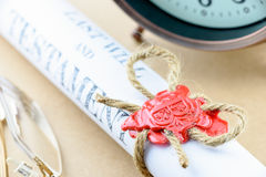 Rolled up scroll of last will and testament fastened with natural brown jute twine hemp rope. Royalty Free Stock Photos