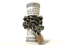 Rolled Up And Shackled Dollars Standing Royalty Free Stock Photo