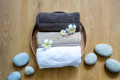 Ayruvedic massage, natural beauty, pampering meditation over pebbles and wood stock photography