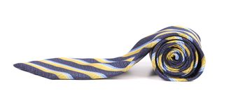 Rolled up stripy necktie Royalty Free Stock Photos