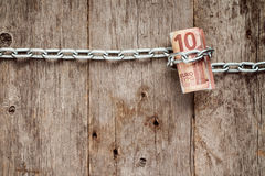 Rolled up Ten euro bills in chains Royalty Free Stock Image