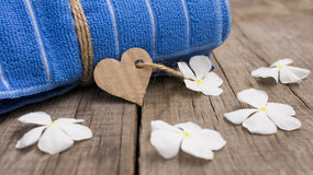 Rolled up towel and paper heart royalty free stock images