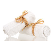 Rolled up towels. With reflections on pure white background Royalty Free Stock Photography