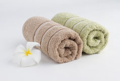 rolled up towels and flower Royalty Free Stock Photo