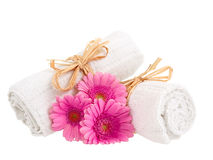 Rolled up towels with flowers Royalty Free Stock Photo