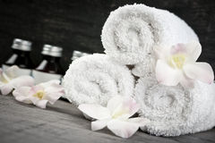 Rolled up towels and products at spa Royalty Free Stock Images