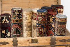 Rolled up turkish carpets in a kist Royalty Free Stock Photos