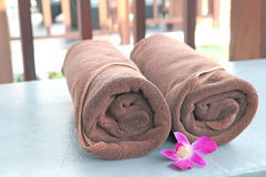 Rolled up of two brown towels on sun lounger chair Royalty Free Stock Photography