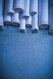 Rolled up white architectural blueprints on Royalty Free Stock Photo