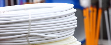 Rolled up of white hose pipe Royalty Free Stock Image