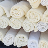 Rolled up white spa towels Royalty Free Stock Photography