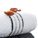 A rolled up white towel. On a white background Stock Photo