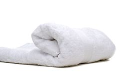 A rolled up white towel Stock Photos