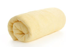 Rolled up yellow beach towel Royalty Free Stock Photos