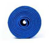 Rolled up yoga mat. Rolled up blue yoga mat isolated on white royalty free stock photos