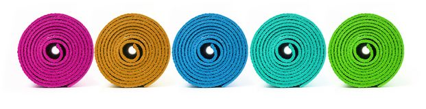 Rolled up yoga mat. Rolled up  yoga mat isolated on white royalty free stock photography