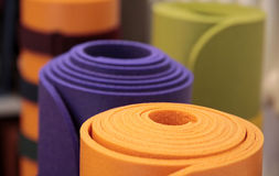 Rolled-up yoga mats. Colorful yoga mats rolled up in a yoga school Royalty Free Stock Photo