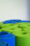 Rolled-up yoga mats. Shallow focus image of colorful, rolled up yoga mats Royalty Free Stock Photography