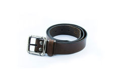 Rolled used mens leather belt with metal buckle isolated on whit Royalty Free Stock Photo