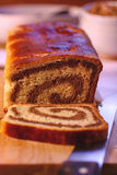 Rolled walnut cake. On table Royalty Free Stock Photos